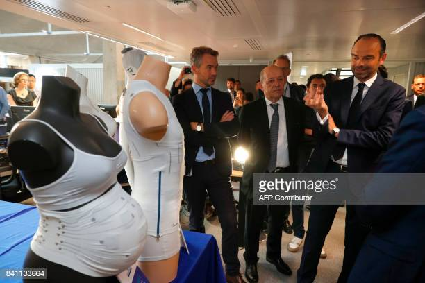 French Foreign Affairs Minister JeanYves Le Drian and French Prime Minister Edouard Philippe visit the startup incubator 'Station F' in Paris France...