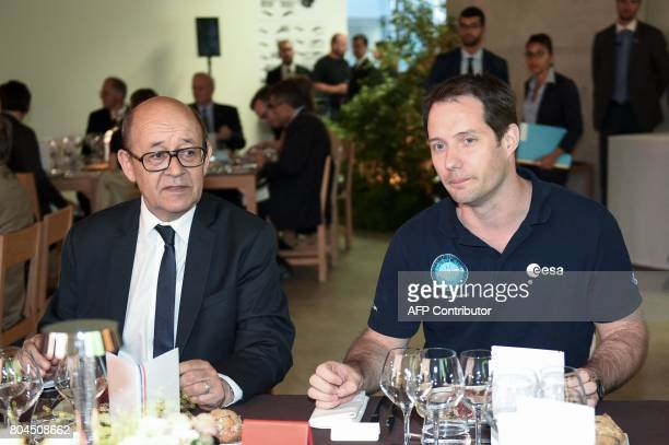 French Foreign Affairs Minister JeanYves Le Drian and French astronaut Thomas Pesquet attend a dinner during a seminar in Nancy on June 30 2017 / AFP...