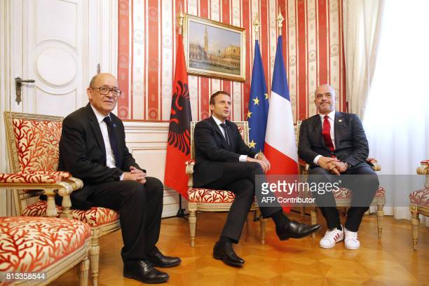 French Foreign Affairs Minister JeanYves Le Drian French President Emmanuel Macron and Albania's Prime Minister Edi Rama hold a meeting on the...