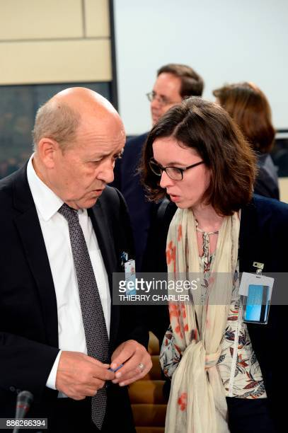 French Foreign Affairs Minister JeanYves Le Drian speaks with French NATO Permanent Representative Helene Duchene before a NATO Foreign Affairs...