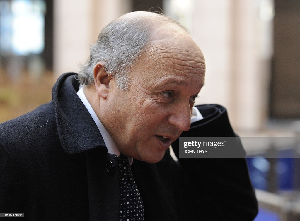 French Foreign Affairs minister Laurent Fabius arrives before a Foreign Affairs Council at the EU Headquarters in Brussels on February 18, 2013. European foreign ministers discuss renewing sanctions on Syria and the possibly of lifting an arms embargo. Talks will also focus on the Mali crisis and Zimbabwe.