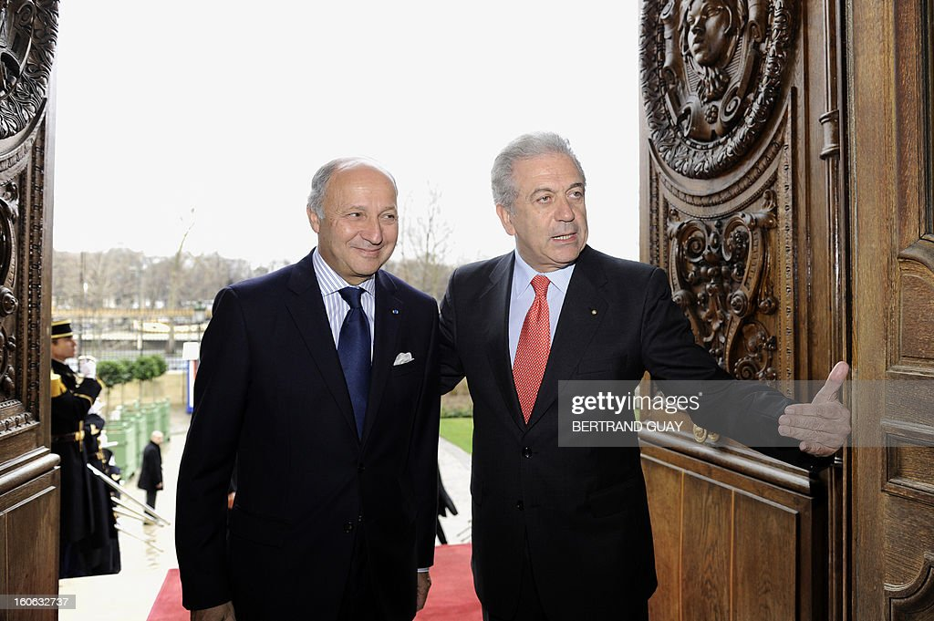 French Foreign Affairs Minister Laurent Fabius (L) poses with his Greek counterpart Dimitris Avramopoulos before a press conference in February 4, 2013 in Paris .