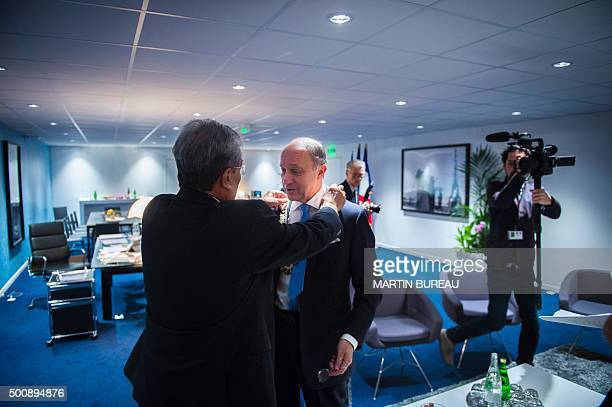 French Foreign Affairs minister Laurent Fabius receives a necklace from Marshall Islands' Foreign Affairs minister Tony deBrum during the COP 21...