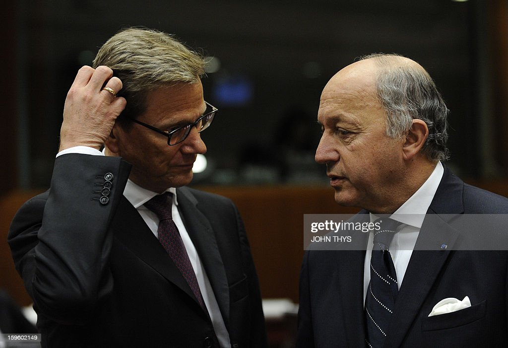 French Foreign Affairs minister Laurent Fabius (R) speaks with German Foreign minister Guido Westerwelle (L) before a EU Foreign Affairs ministers council on Mali conflit at the EU Headquarters in Brussels on January 17, 2013.