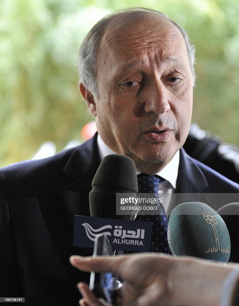 French Foreign Affairs minister Laurent Fabius talks to the press prior tto he Donor Conference for development in Mali on May 15, 2013 at the EU Headquarters in Brussels. The EU and France will gather international donors to drum up aid and support for Mali as it seeks to move on from a war against hardline Islamists and end a two-year old political crisis. The conference will be attended by French President Francois Hollande, his Malian counterpart Dioncounda Traore, European Commission chief Jose Manuel Barroso and heads of state from several west African countries.