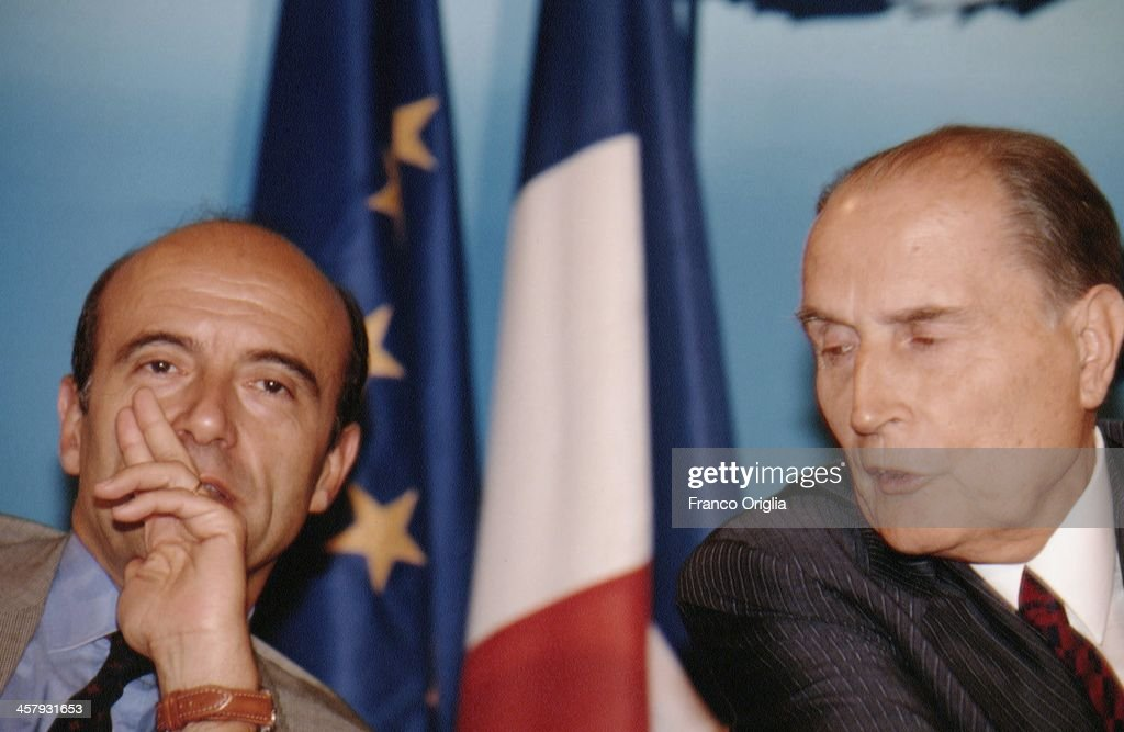 French Foreign Minister <a gi-track='captionPersonalityLinkClicked' href=/galleries/search?phrase=Alain+Juppe&family=editorial&specificpeople=235359 ng-click='$event.stopPropagation()'>Alain Juppe</a> (L) and French President <a gi-track='captionPersonalityLinkClicked' href=/galleries/search?phrase=Francois+Mitterrand&family=editorial&specificpeople=208938 ng-click='$event.stopPropagation()'>Francois Mitterrand</a> attend a conference during the G7 Summit at the Royal Palace of Naples, Piazza del Plebiscito, on July 10, 1994 in Naples, Italy.