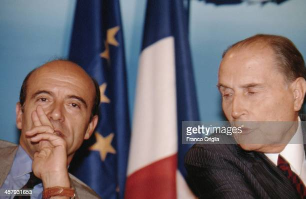 French Foreign Minister Alain Juppe and French President Francois Mitterrand attend a conference during the G7 Summit at the Royal Palace of Naples...