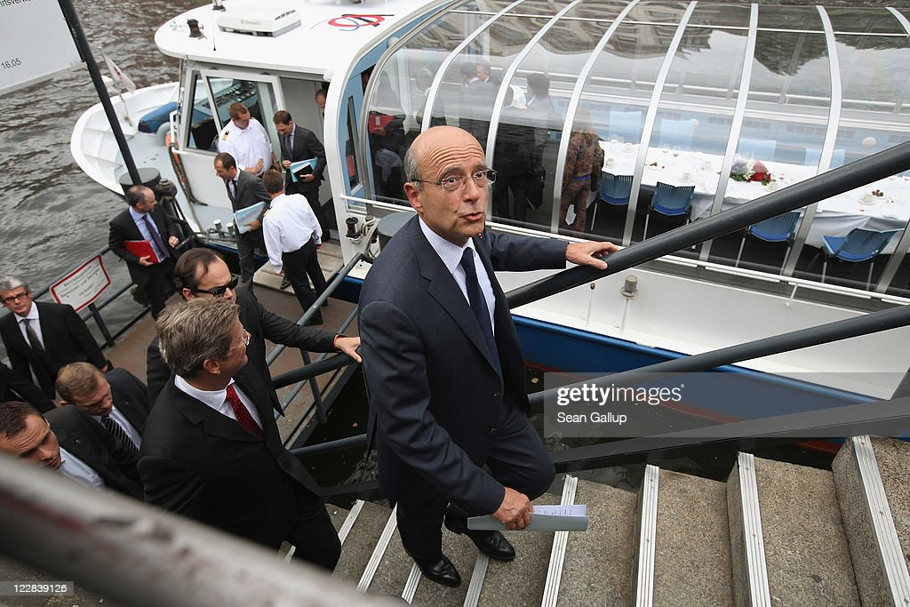 French Foreign Minister <a gi-track='captionPersonalityLinkClicked' href=/galleries/search?phrase=Alain+Juppe&family=editorial&specificpeople=235359 ng-click='$event.stopPropagation()'>Alain Juppe</a> (C) and German Foreign Minister <a gi-track='captionPersonalityLinkClicked' href=/galleries/search?phrase=Guido+Westerwelle&family=editorial&specificpeople=208748 ng-click='$event.stopPropagation()'>Guido Westerwelle</a> (L) arriving after holding talks on a boat on the Spree river on August 29, 2011 in Berlin, Germany. The two men discussed stability of the Euro and the current situation in Libya, among other matters.