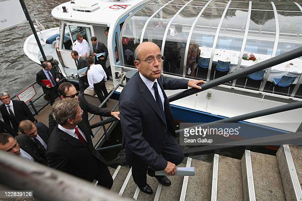 French Foreign Minister Alain Juppe and German Foreign Minister Guido Westerwelle arriving after holding talks on a boat on the Spree river on August...