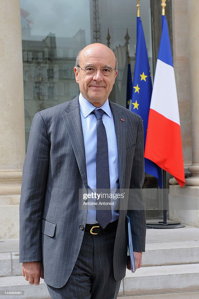 French Foreign Minister <a gi-track='captionPersonalityLinkClicked' href=/galleries/search?phrase=Alain+Juppe&family=editorial&specificpeople=235359 ng-click='$event.stopPropagation()'>Alain Juppe</a> leaves the weekly cabinet meeting at Elysee Palace on May 9, 2012 in Paris, France.