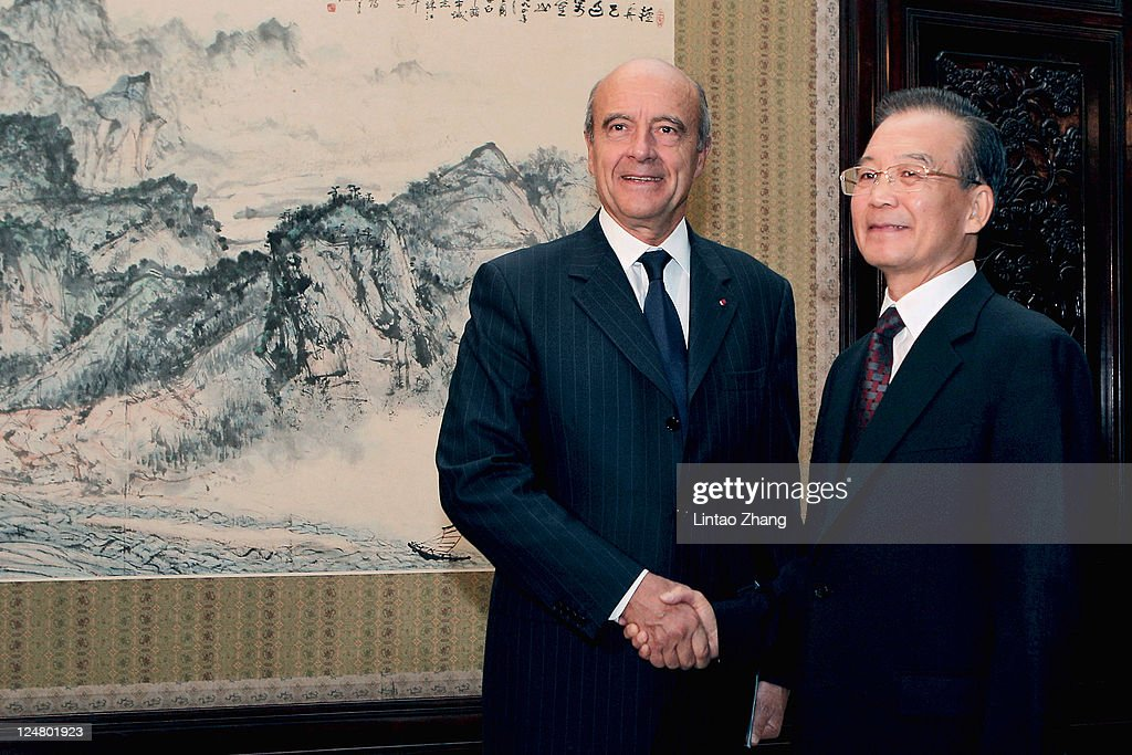 French Foreign Minister <a gi-track='captionPersonalityLinkClicked' href=/galleries/search?phrase=Alain+Juppe&family=editorial&specificpeople=235359 ng-click='$event.stopPropagation()'>Alain Juppe</a> (L) shakes hands with Chinese Premier <a gi-track='captionPersonalityLinkClicked' href=/galleries/search?phrase=Wen+Jiabao&family=editorial&specificpeople=204598 ng-click='$event.stopPropagation()'>Wen Jiabao</a> during their meeting at the Zhongnanhai leaders' compound on September 13, 2011 in Beijing, China. Juppe will be in China on a three-day visit to discuss China's need to increase the value of its currency.