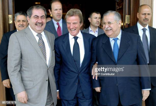 French Foreign Minister Bernard Kouchner shares a laugh with Iraqi President Jalal Talabani and Iraqi Foreign Minister Hoshiyar Zebari in Baghdad 20...
