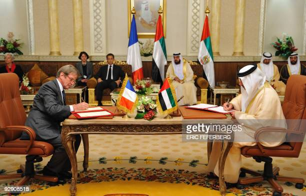 French Foreign Minister Bernard Kouchner signs a cooperation agreement with an unidentified Emirati minister on May 26 2009 at AlMushrif presidential...