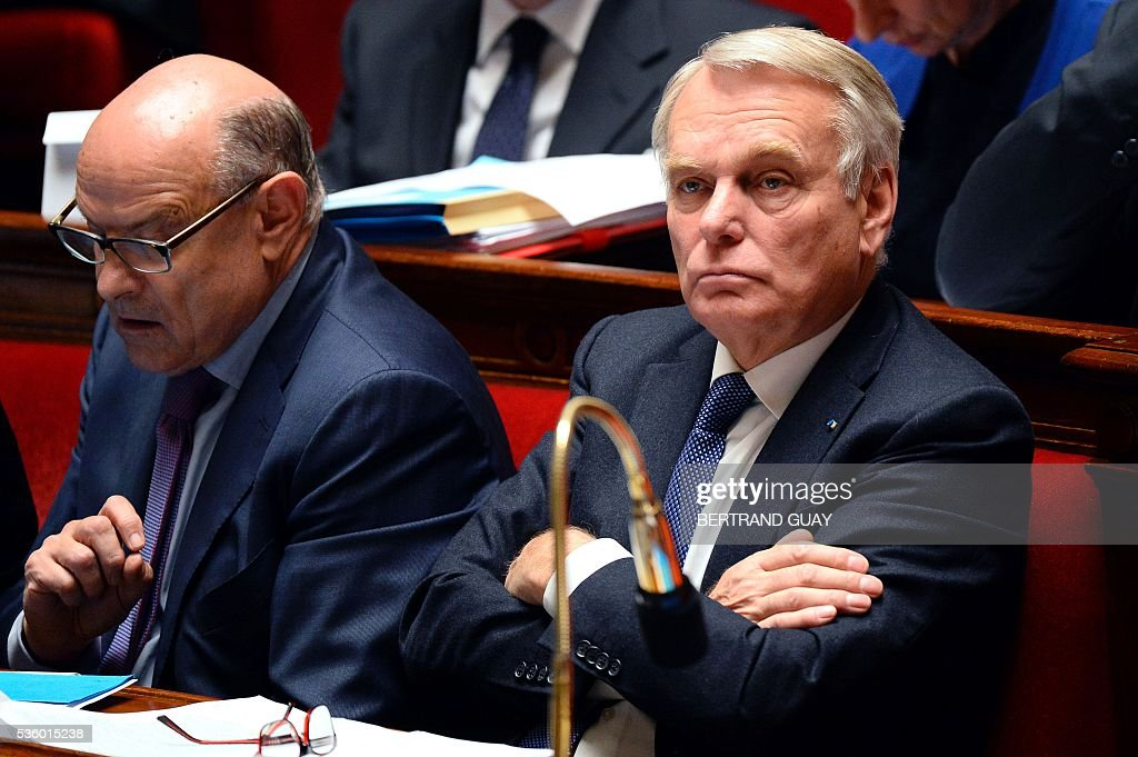 French Foreign Minister Jean-Marc Ayrault (R) and French Junior Minister for Parliamentary Relations Jean-Marie Le Guen attend a session of questions to the Government at the French National Assembly in Paris, on May 31, 2016.