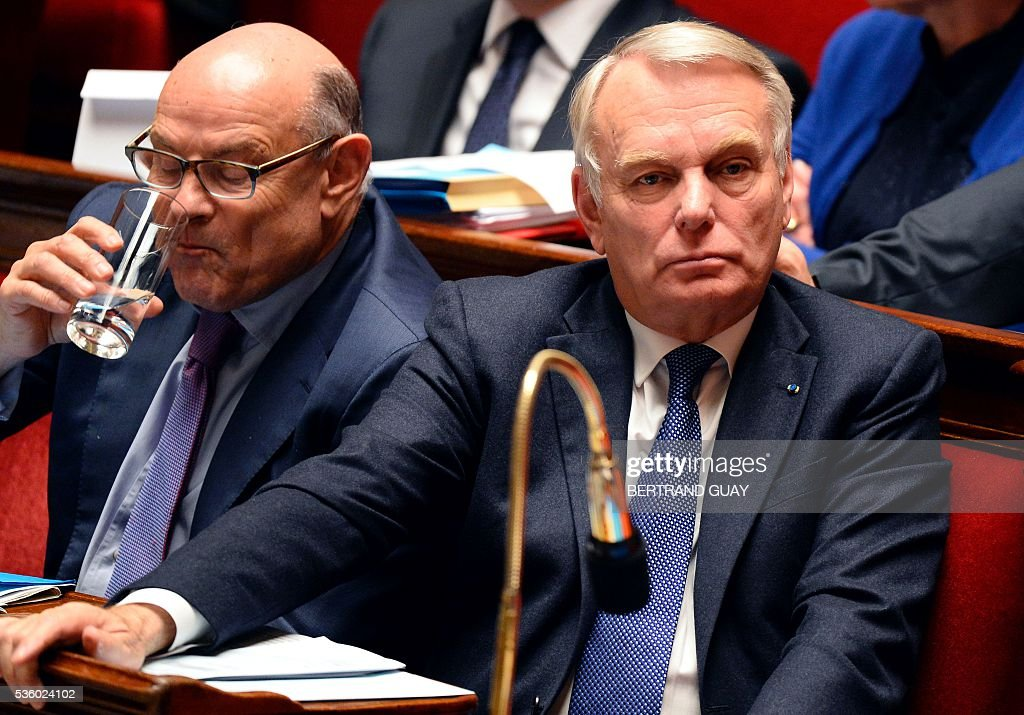 French Foreign Minister Jean-Marc Ayrault (R) attends a session of questions to the Government at the French National Assembly in Paris, on May 31, 2016.