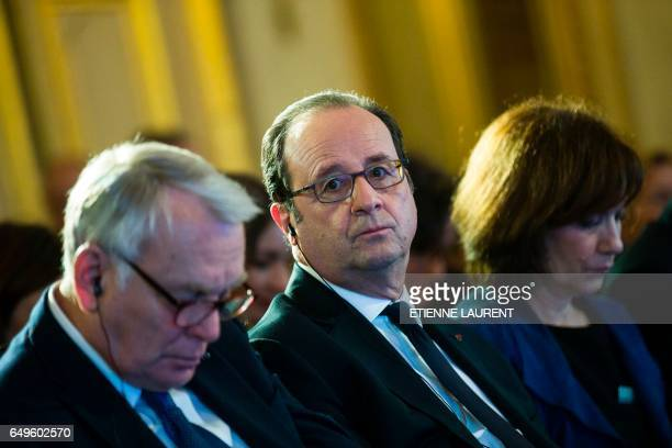 French Foreign Minister JeanMarc Ayrault French President Francois Hollande and French Minister for Families Children and Womens Rights Laurence...