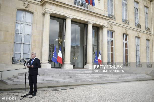 French Foreign Minister JeanMarc Ayrault gives a statement to the media following a Defence Cabinet meeting on April 26 2017 at the Elysee Palace in...
