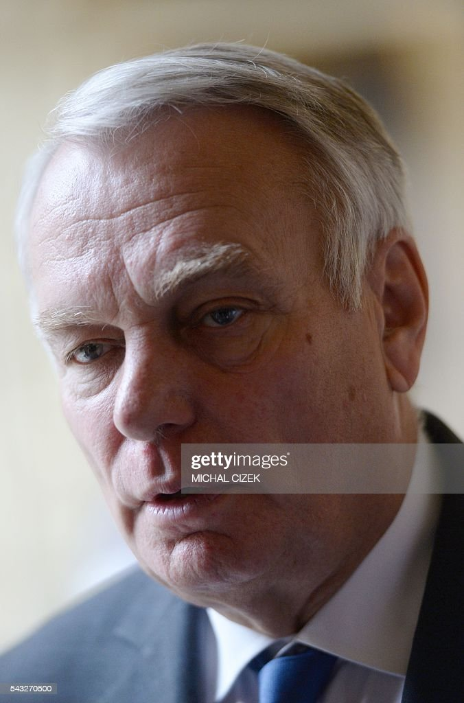 French Foreign Minister Jean-Marc Ayrault gives an interview after the press conference of V4 Visegrad Group Foreign Ministers plus German and French Foreign Ministers meeting after the Brexit referendum on June 27, 2016, in Prague. / AFP / Michal Cizek