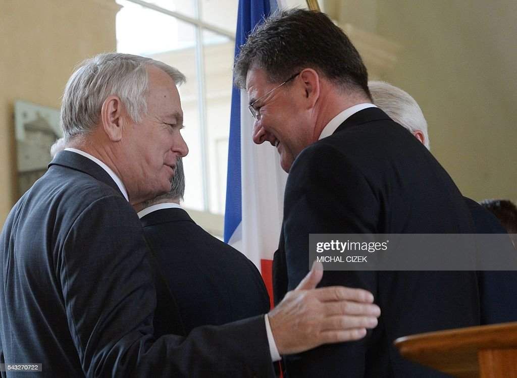 French Foreign Minister Jean-Marc Ayrault (L) speaks with Slovakia's Foreign Minister Miroslav Lajcak after the press conference of V4 Visegrad Group Foreign Ministers plus German and French Foreign Ministers meeting after the Brexit referendum on June 27, 2016, in Prague. / AFP / Michal Cizek