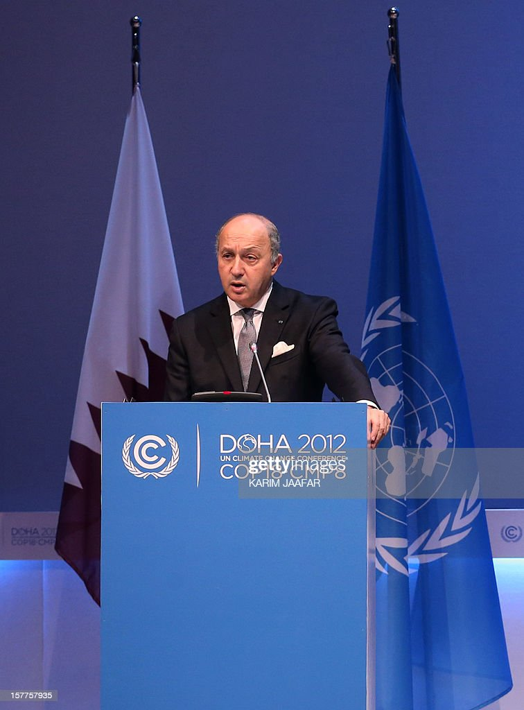 French Foreign minister Laurent Fabius addresses delegates during the penultimate day of the United Nations Framework Convention on Climate Change (UNFCCC) in the Qatari capital Doha, on December 6, 2012. Negotiators from nearly 200 countries entered the penultimate day of UN climate talks in Doha divided on near-term finance for poor nations' global warming mitigation plans.
