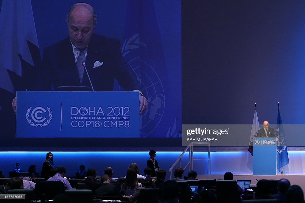 French Foreign minister Laurent Fabius (Bottom-R) addresses delegates during the penultimate day of the United Nations Framework Convention on Climate Change (UNFCCC) in the Qatari capital Doha, on December 6, 2012. Negotiators from nearly 200 countries entered the penultimate day of UN climate talks in Doha divided on near-term finance for poor nations' global warming mitigation plans.