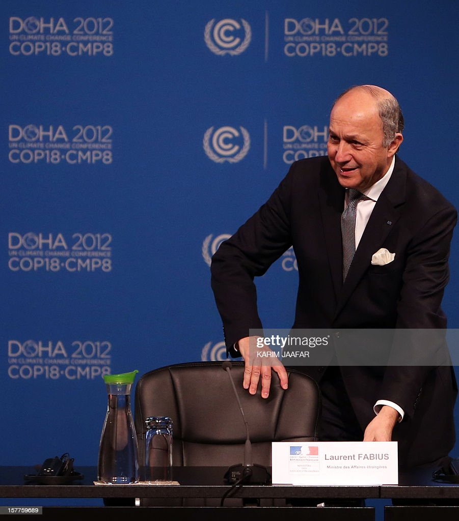 French Foreign minister Laurent Fabius addresses delegates during the penultimate day of the United Nations Framework Convention on Climate Change (UNFCCC) in the Qatari capital Doha, on December 6, 2012. Negotiators from nearly 200 countries entered the penultimate day of UN climate talks in Doha divided on near-term finance for poor nations' global warming mitigation plans. AFP PHOTO /KARIM JAAFAR / AL-WATAN DOHA == QATAR OUT ==