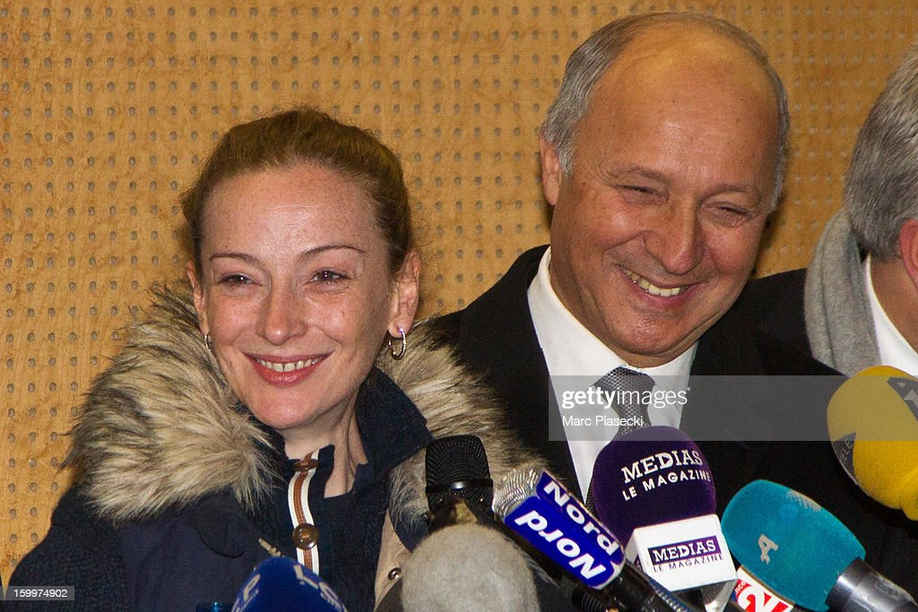 French Foreign Minister Laurent Fabius and Florence Cassez arrive to attend a Press conference following her release from prison in Mexico at Charles-de-Gaulle airport on January 24, 2013 in Paris, France. A Supreme Court in Mexico voted to free Florence Cassez, 38, from France who was serving out a 60-year sentence for kidnapping. The decision was made after it was decided her rights were violated by a television broadcast of a staged raid on the kidnappers by the police when in fact the alleged kidnappers, including Cassez, were arrested the previous day on a highway.