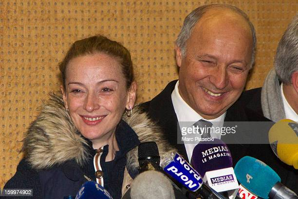 French Foreign Minister Laurent Fabius and Florence Cassez arrive to attend a Press conference following her release from prison in Mexico at...
