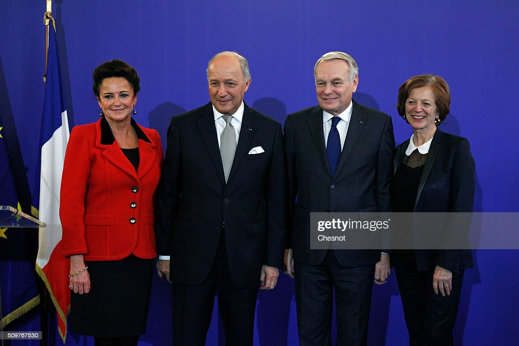 French Foreign Minister Laurent Fabius (2ndL) and his wife Marie-France Marchand-Baylet (L) pose with newly appointed French Foreign Minister Jean-Marc Ayrault (2ndR) and his wife Brigitte Ayrault during the handover ceremony on February 12, 2016 in Paris, France. French President Francois Hollande has appointed Jean-Marc Ayrault Foreign Minister during the reshuffle of February 11, 2016.