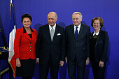 French Foreign Minister Laurent Fabius and his wife MarieFrance MarchandBaylet pose with newly appointed French Foreign Minister JeanMarc Ayrault and...
