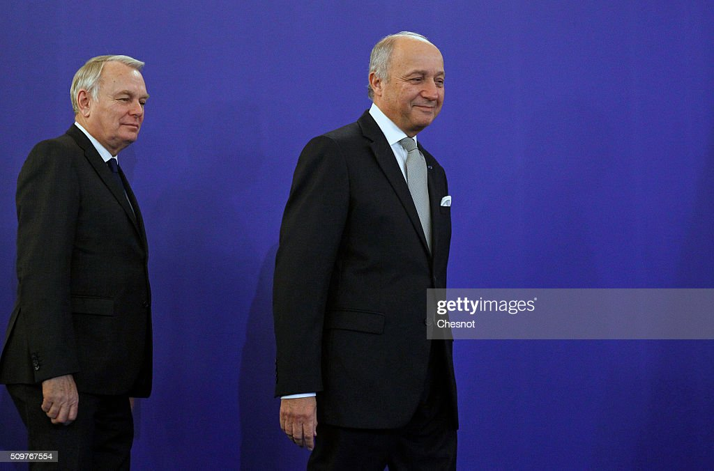 French Foreign Minister Laurent Fabius (R) and newly-appointed Foreign Minister Jean-Marc Ayrault arrive to attend the official handover ceremony at the Ministry of Foreign Affairs on February 12, 2016 in Paris, France. French President Francois Hollande has appointed Jean-Marc Ayrault Foreign Minister during the reshuffle of February 11, 2016.
