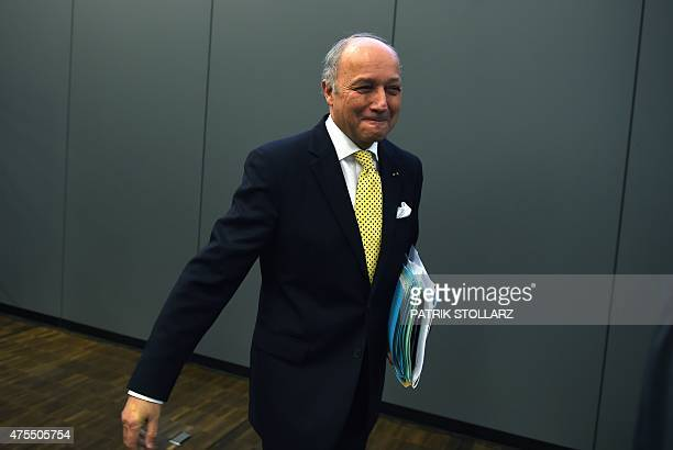 French Foreign Minister Laurent Fabius arrives for the United Nations Framework Convention on Climate Change opening ceremony in Bonn western Germany...
