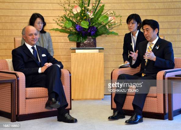 French Foreign Minister Laurent Fabius attends a meeting with Japanese Prime Minister Shinzo Abe at Abe's office in Tokyo on May 7 2013 AFP PHOTO /...