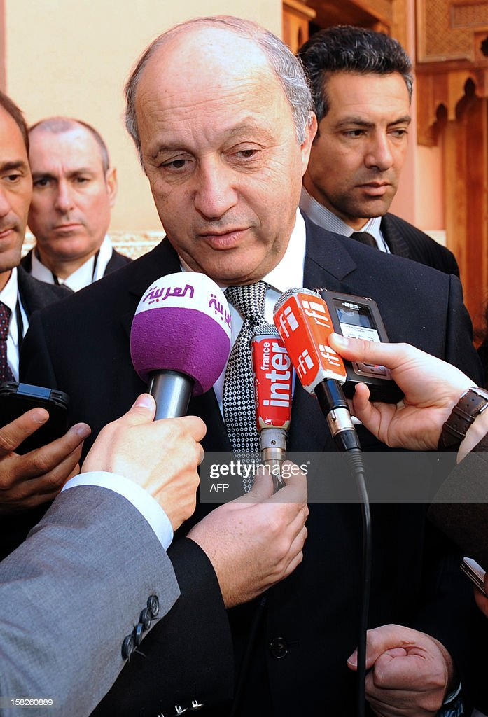 French Foreign Minister Laurent Fabius (C) attends the Friends of Syria conference in Marrakesh on December 12, 2012. The Friends of Syria nations opposed to President Bashar al-Assad mEet in Morocco to look afresh at how to resolve the deepening crisis and support the new opposition group after it won official US backing.