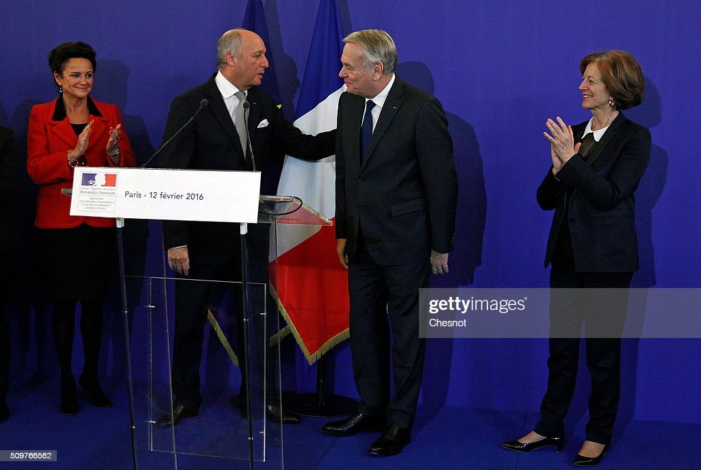 French Foreign Minister <a gi-track='captionPersonalityLinkClicked' href=/galleries/search?phrase=Laurent+Fabius&family=editorial&specificpeople=540660 ng-click='$event.stopPropagation()'>Laurent Fabius</a> (2ndR) congratulates newly appointed French Foreign Minister <a gi-track='captionPersonalityLinkClicked' href=/galleries/search?phrase=Jean-Marc+Ayrault&family=editorial&specificpeople=551961 ng-click='$event.stopPropagation()'>Jean-Marc Ayrault</a> next to Marie-France Marchand Baylet (L) and Brigitte Ayrault (R) during the handover ceremony on February 12, 2016 in Paris, France. French President Francois Hollande has appointed <a gi-track='captionPersonalityLinkClicked' href=/galleries/search?phrase=Jean-Marc+Ayrault&family=editorial&specificpeople=551961 ng-click='$event.stopPropagation()'>Jean-Marc Ayrault</a> Foreign Minister during the reshuffle of February 11, 2016.