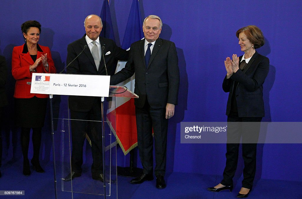 French Foreign Minister Laurent Fabius (2ndR) congratulates newly appointed French Foreign Minister Jean-Marc Ayrault next to Marie-France Marchand Baylet (L) and Brigitte Ayrault (R) during the handover ceremony on February 12, 2016 in Paris, France. French President Francois Hollande has appointed Jean-Marc Ayrault Foreign Minister during the reshuffle of February 11, 2016.