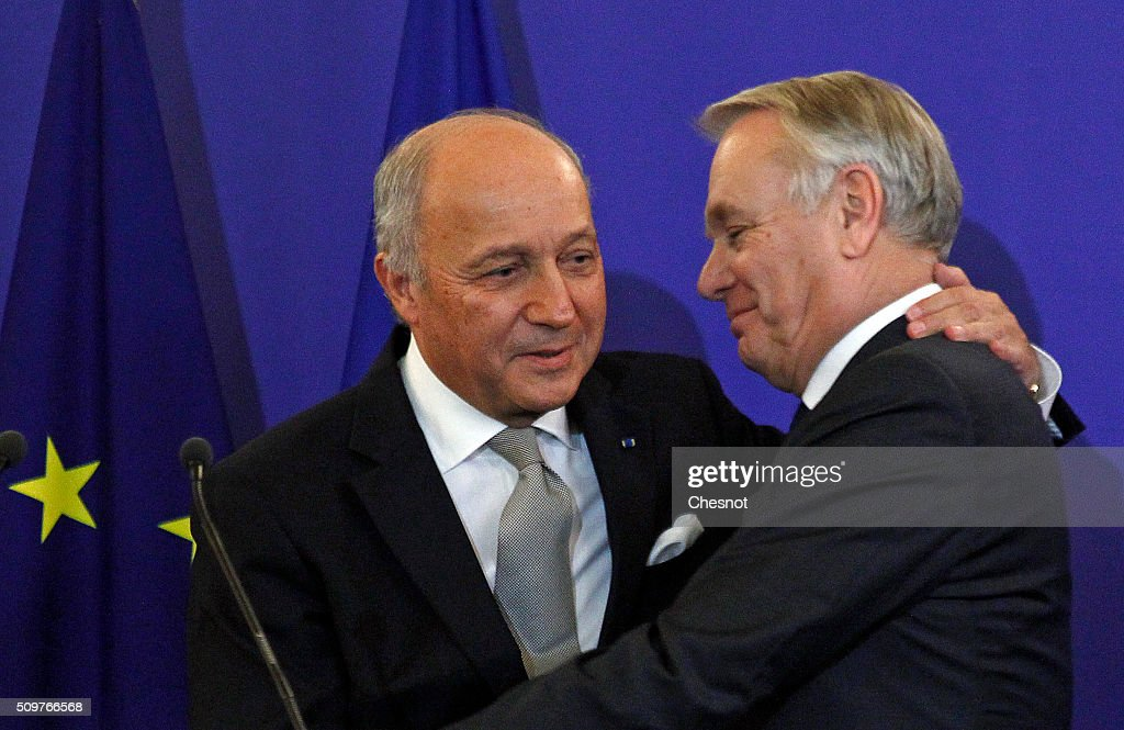 French Foreign Minister Laurent Fabius (L) congratulates newly-appointed Foreign Minister Jean-Marc Ayrault during the official handover ceremony at the Ministry of Foreign Affairs on February 12, 2016 in Paris, France. French President Francois Hollande has appointed Jean-Marc Ayrault Foreign Minister during the reshuffle of February 11, 2016.