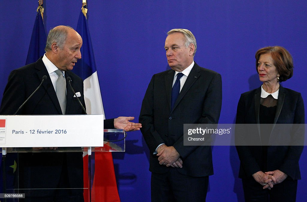 French Foreign Minister Laurent Fabius delivers a speech next to newly appointed French Foreign Minister Jean-Marc Ayrault and his wife Brigitte Ayrault during the handover ceremony on February 12, 2016 in Paris, France. French President Francois Hollande has appointed Jean-Marc Ayrault Foreign Minister during the reshuffle of February 11, 2016.