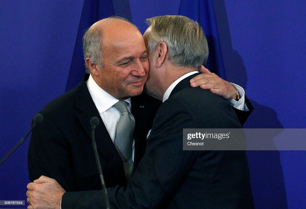 French Foreign Minister Laurent Fabius (L) embraces newly-appointed Foreign Minister Jean-Marc Ayrault during the official handover ceremony at the Ministry of Foreign Affairs on February 12, 2016 in Paris, France. French President Francois Hollande has appointed Jean-Marc Ayrault Foreign Minister during the reshuffle of February 11, 2016.