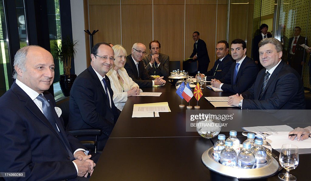 French Foreign Minister Laurent Fabius (L), French President Francois Hollande (2nd L) and President of Macedonia <a gi-track='captionPersonalityLinkClicked' href=/galleries/search?phrase=Gjorge+Ivanov+-+Politician&family=editorial&specificpeople=12777955 ng-click='$event.stopPropagation()'>Gjorge Ivanov</a> (R) attend a 'Brdo Process' leaders' meeting at Brdo Castle, in Brdo Pri Kranju north of Ljubljana, on July 25, 2013. The presidents of eight western Balkans countries along with French president Francois Hollande met in Slovenia at an unprecedented summit aimed at promoting cooperation and further EU enlargement in the region. The summit was organized by the presidents of the only two former Yugoslav states that joined the EU, Slovenia's Borut Pahor and Croatia's Ivo Josipovic, and backed by the French president underlining the need for reforms for all Balkans states that would like to join the EU.
