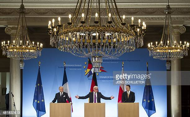 French Foreign Minister Laurent Fabius German Foreign Minister FrankWalter Steinmeier and Polish counterpart Radoslaw Sikorski give a joint press...