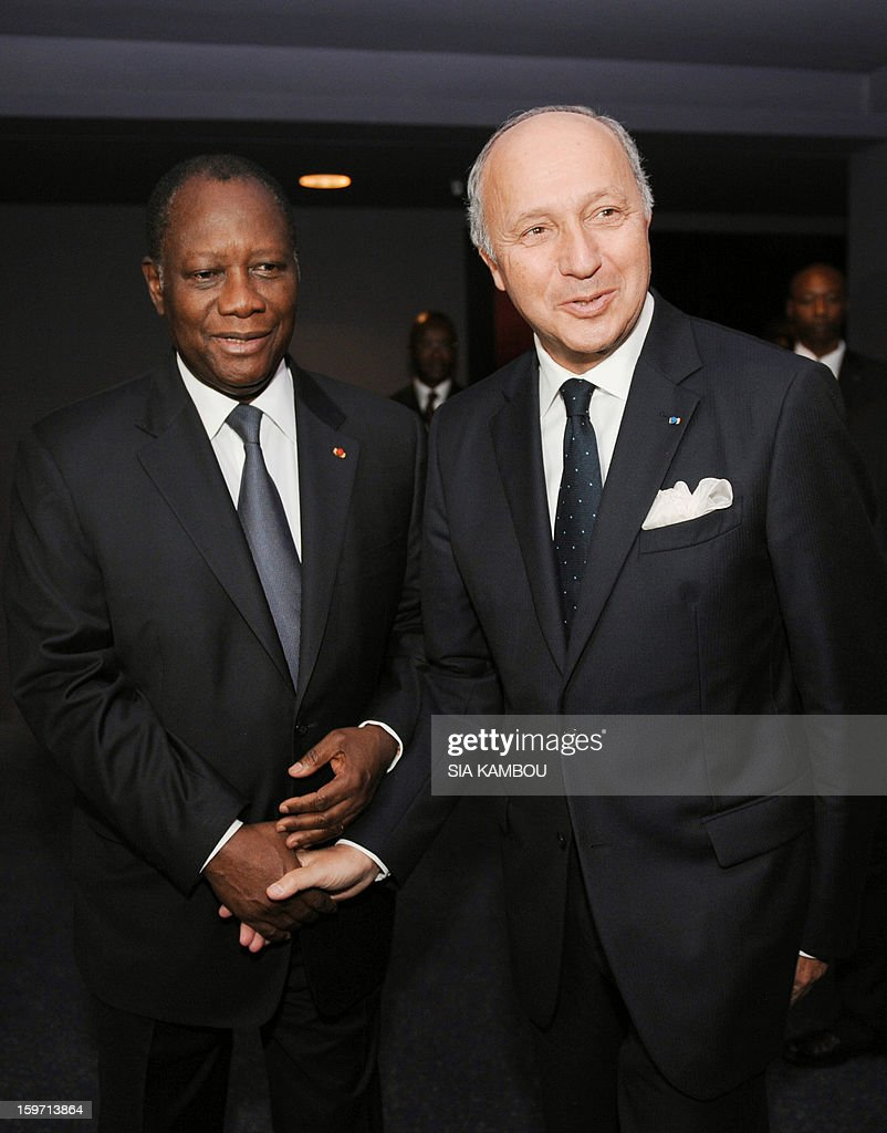 French Foreign Minister Laurent Fabius (R) is welcome by Ivory Coast's President and ECOWAS chairman Alassane Ouattara (L) on January 19, 2013 in Abidjan, prior to an emergency summit of west African bloc (ECOWAS) to discuss the foreign intervention in Mali. The summit takes place with ECOWAS countries promising to send more than 3,000 soldiers to join French forces backing the Malian army against Islamist rebels.