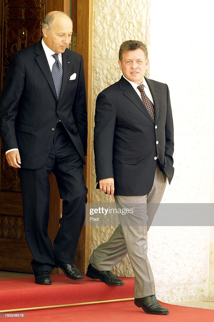 French Foreign Minister <a gi-track='captionPersonalityLinkClicked' href=/galleries/search?phrase=Laurent+Fabius&family=editorial&specificpeople=540660 ng-click='$event.stopPropagation()'>Laurent Fabius</a> (L) leaves after talks with Jordan's King Abdullah II (R) at the royal palace on August 16, 2012 in Amman, Jordan. Before the meeting, Fabius visited the UN-run Zaatari Syrian refugee camp, outside the Jordanian northern city of Mafraq.
