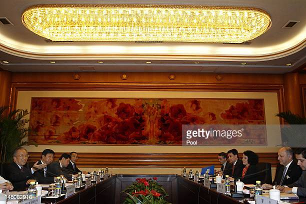 French Foreign Minister Laurent Fabius listens as Chinese State Councilor Dai Bingguo speaks during a meeting at the Zhongnanhai compound on July 9...
