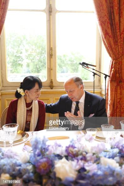 French Foreign Minister Laurent Fabius meets with Burmese politician Aung San Suu Kyi at the Quai d'Orsay on June 27 2012 in Paris France