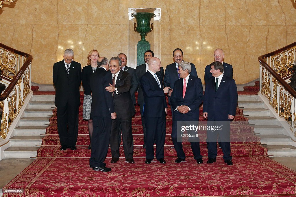 French foreign minister Laurent Fabius, Saudi Prince Saud al-Faisal, British foriegn minister William Hague, US Secretary of State John Kerry and Turkish foreign minister Ahmet Davutoglu, (Back L-R) Egyptian deputy foreign minister Egypt Hamdi Sanad Loza, German State Secretary of the Federal Foreign Office Emily Haber, Jordanian foreign minister Nasser Judeh, UAE foreign minister Sheikh Abdullah Bin Zayed al-Nahyan, Qatari foreign minister Khalid bin Mohamed al-Attiyah and Italian deputy foreign minister Lapo Pistelli prepare to pose for a group photograph before conducting a meeting of the 'London 11', from the Friends of Syria Core Group, in Lancaster House on October 22, 2013 in London, England. The meeting, hosted by British Foreign Secretary William Hague, brings together Foreign Ministers from: the USA, Egypt, France, Germany, Italy, Jordan, Qatar, Saudi Arabia, Turkey and UAE as well as representatives from the Syrian National Coalition.