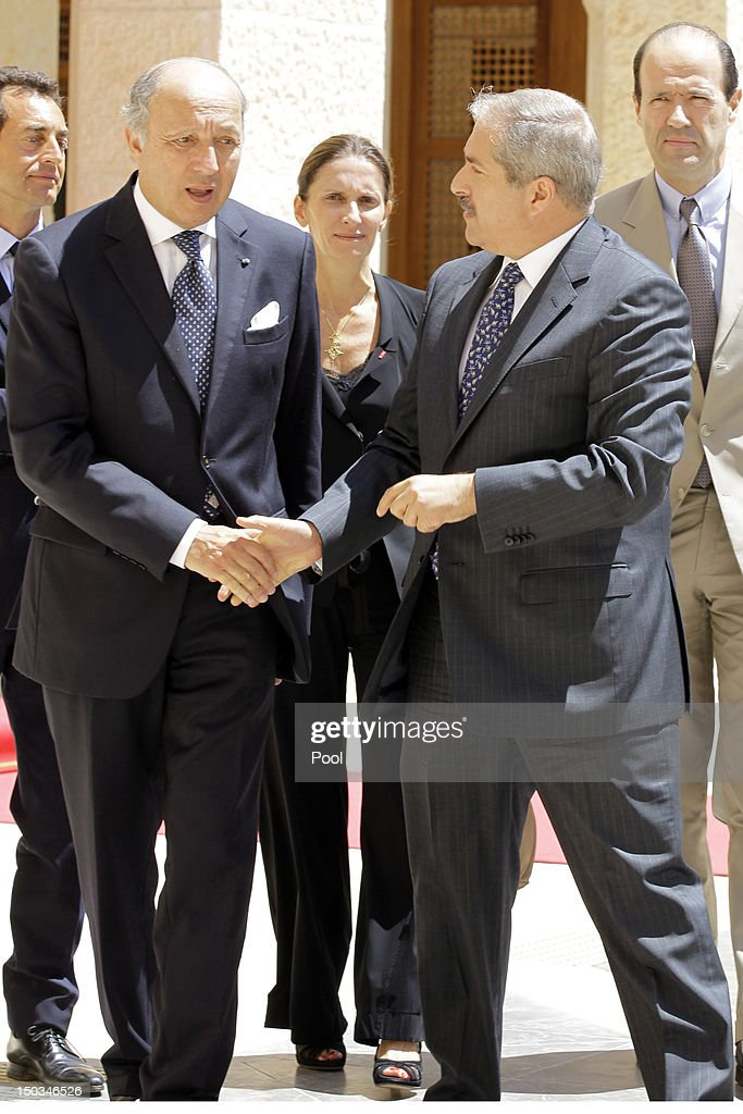French Foreign Minister <a gi-track='captionPersonalityLinkClicked' href=/galleries/search?phrase=Laurent+Fabius&family=editorial&specificpeople=540660 ng-click='$event.stopPropagation()'>Laurent Fabius</a> (L) shakes hands with his Jordanian counterpart <a gi-track='captionPersonalityLinkClicked' href=/galleries/search?phrase=Nasser+Judeh&family=editorial&specificpeople=3465453 ng-click='$event.stopPropagation()'>Nasser Judeh</a>, after talks with Jordan's King Abdullah II at the royal palace on August 16, 2012 in Amman, Jordan. Before the meeting, Fabius visited the UN-run Zaatari Syrian refugee camp, outside the Jordanian northern city of Mafraq.