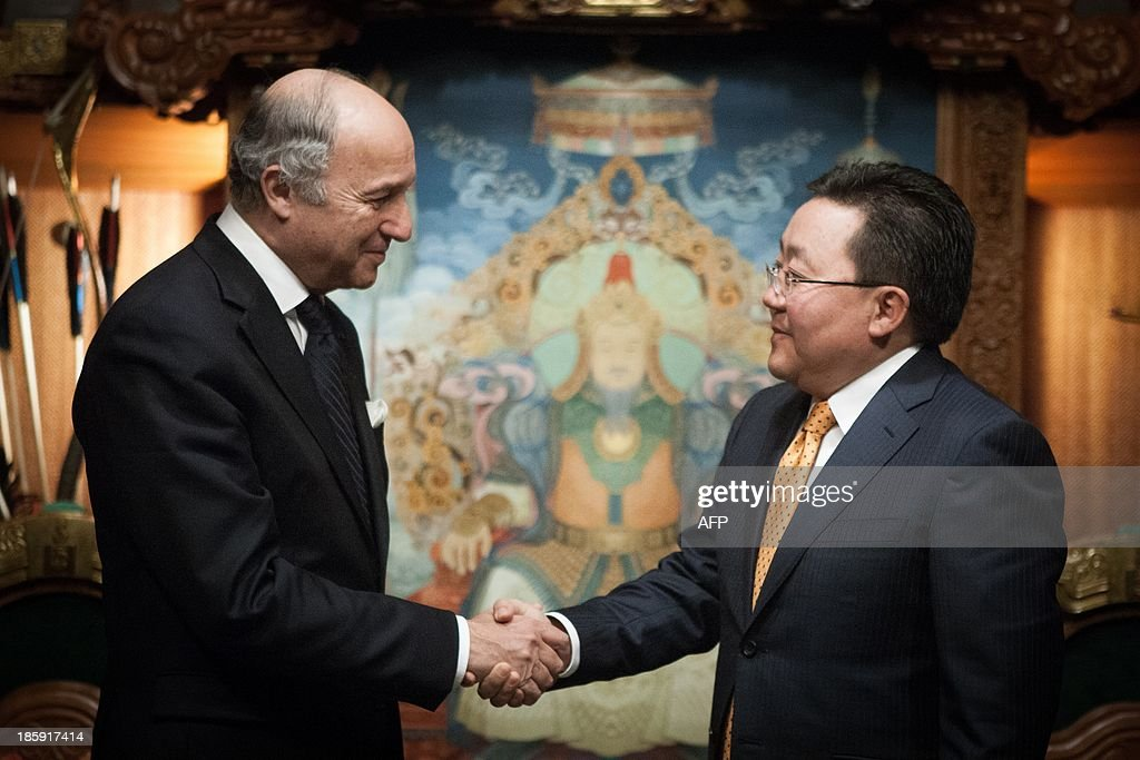 French foreign minister Laurent Fabius (L) shakes hands with Mongolian president Elbegdorj Tsakhia during his visit to Mongolia in Ulan Bator on October 26, 2013. French nuclear energy giant Areva signed a deal with Mongolia's state-owned Mon-Atom on Saturday to develop two uranium mines in the Gobi desert, officials said.