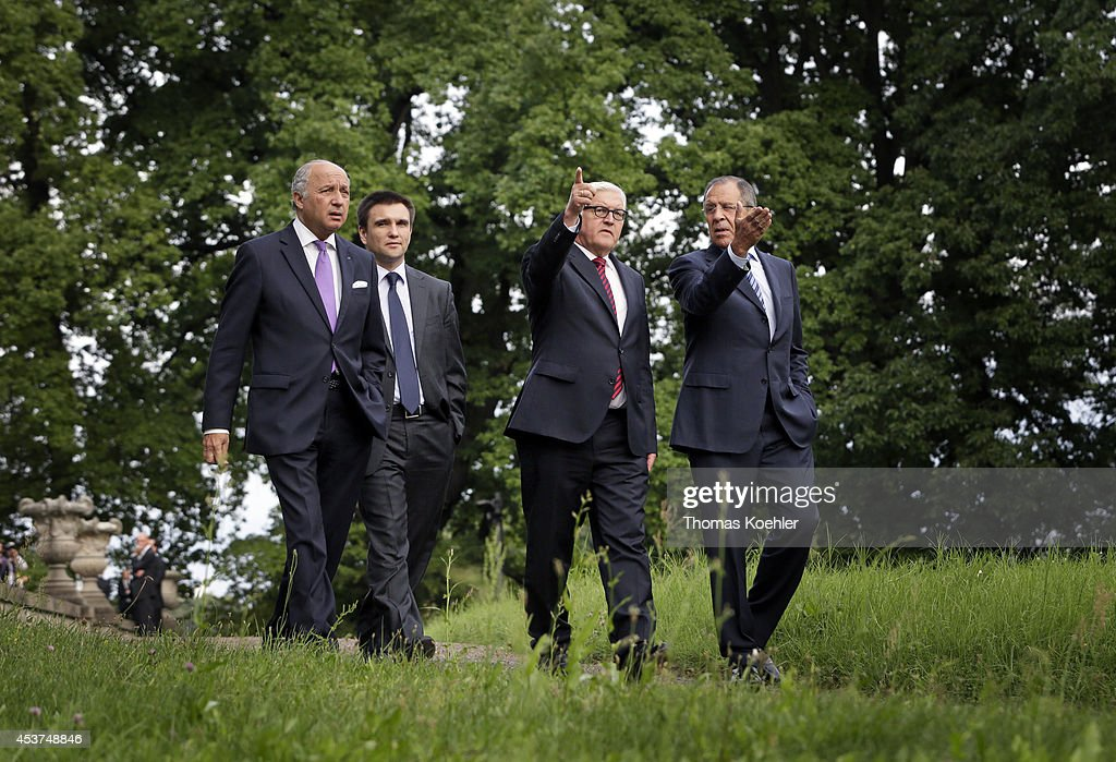 French Foreign Minister Laurent Fabius, Ukrainian Foreign Minister Pavlo Klimkin, German Foreign Minister Frank-Walter Steinmeier and Russian Foreign Minister Sergey Lavrov walk in the villa garden while meeting to discuss the ongoing conflict in eastern Ukraine at Villa Borsig on August 17, 2014 in Berlin, Germany. The four men are meeting following the one confirmed incursion by military vehicles from Russian soil into Ukraine and the statement by a separatist leader that Russia had supplied them with heavy tanks, training and personnel, which has heightened tension and increased fears of a possible imminent Russian invasion.