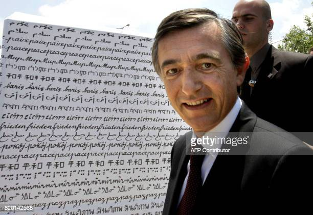 French Foreign Minister Philippe DousteBlazy walks past artwork during the inauguration of an exhibition by French artist Clara Halter called 'Peace...